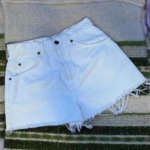 Vintage Levi's cut off white denim jean shorts